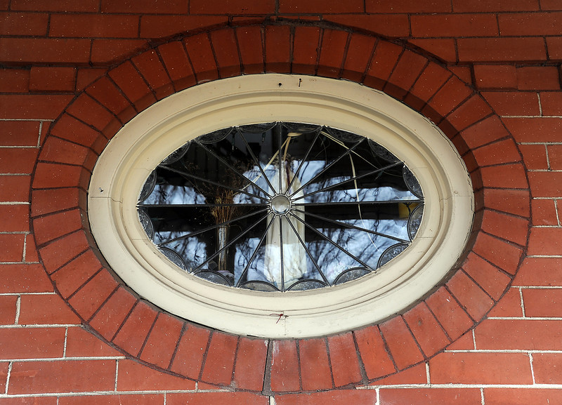 This oval-shaped leaded glass window is one of the unique features of Nancy Boeh-Patton's historical Loveland home, built in 1905.
