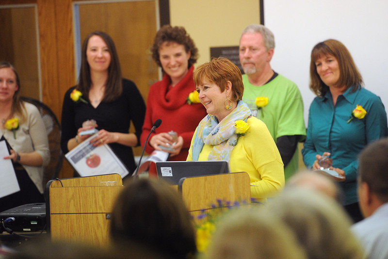 Truscott Elementary School third-grade teacher Delaine Goldeman, middle, speaks to Crystal Apple Awards ceremony attendees after being given an award along with other elementary school teachers Friday, April 19, 2013 at the Chilson Senior Center.