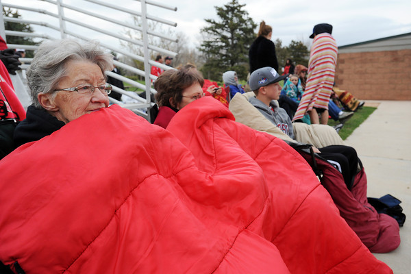 Loveland High School baseball fans, from left to right, Edna Weinmaster, Char Marker and Zach Weinmaster bundle up against the cold weather while watching the team play Fossil Ridge on Tuesday, April 30, 2013 at Swift Field.
