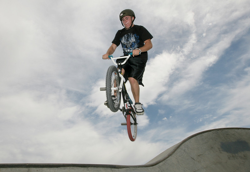 Loveland resident, Michael McClain, attempts a 360 Thursday at the skate park in the Loveland Sports Park.