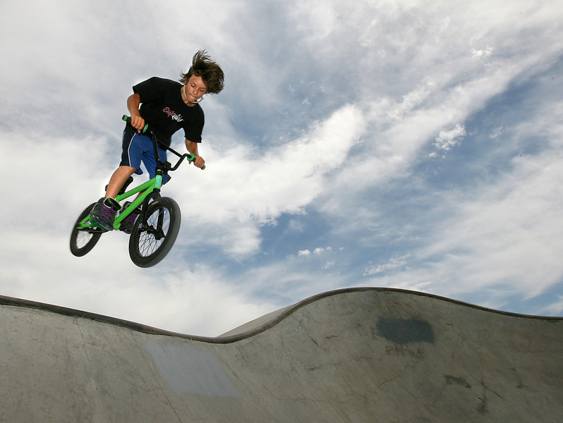 Loveland resident Damon Tice, 13, does a 360 out of the bowl Thursday at the skate park in Loveland Sports Park. Today's forecast will be similar to Thursday' with partly cloudy skies and highs in the low 90s.