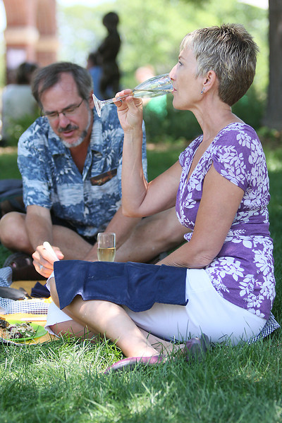 Jan Hambrick, of Erie, takes a sip of wine while having lunch with her sweetheart Bill Hermanson, of Longmont, on Saturday during Sculpture in the Park at Benson Park Sculpture Garden.