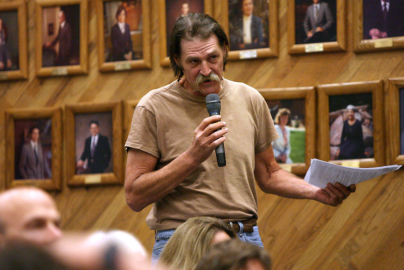 Fort Collins resident, Lawrence Lowry, asks Governor Ritter a question about some of the recent budget cuts that will directly affect him, on Thursday during a town hall meeting at the Fort Collins City Hall.