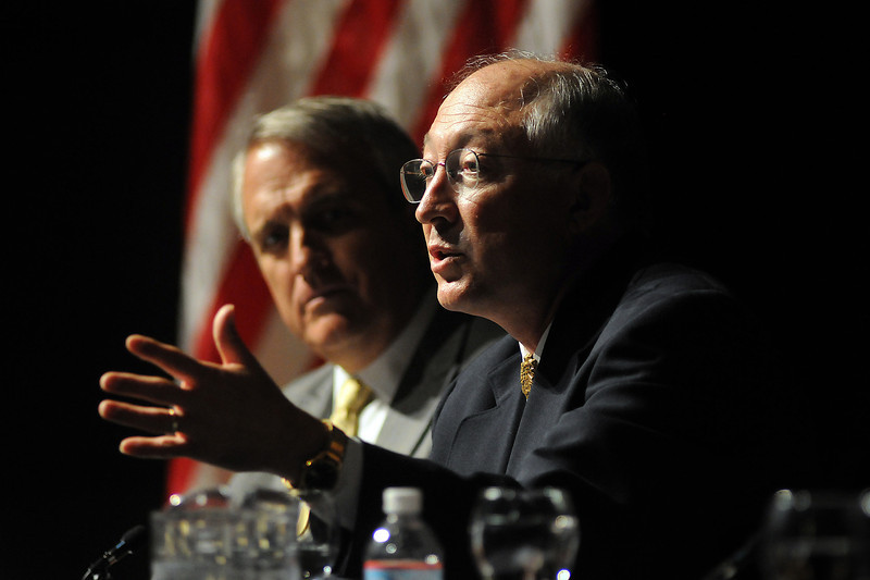 Secretary of the Interior Ken Salazar talks as Gov. Bill Ritter listens during a Clean Energy Economy Forum on Thursday at Fossil Ridge High School.