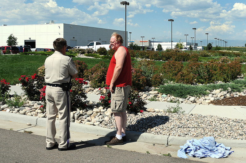 A security guard from Wackenhut Security informs Gary Reeves of Platteville that the Iron Mountain Autoplex where his 2006 Ford Mustang is in for service has been closed for good as a pile of work shirts lie in the gutter. Reeves purchased the car from the autoplex nine weeks ago and the engine blew out after he had the car for two weeks. Reeves was given a phone number to call about his car by an autoplex representative.