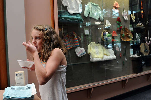 Keirsten Beard, 12, of Loveland eats ice cream in the lobby of the Loveland Public Library during an ice cream social to benefit the expansion of the library. The Friends of the Loveland Public Library sponsored the event to kick off the public phase of their fundraising event in which they hope to raise $2 million for a new building that will nearly double the current library.