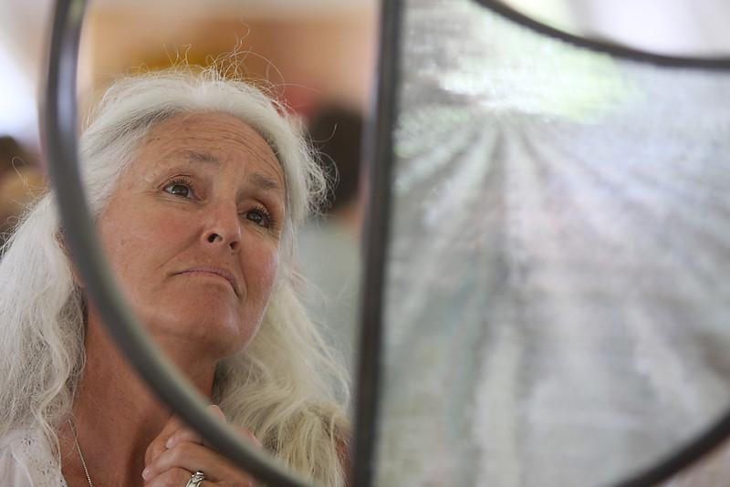 """Marilyn Thissen, of Greeley, admires """"Landscape V"""" by Ken Leap."""