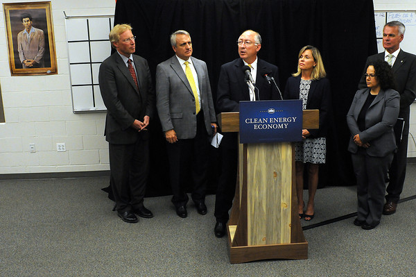 Secretary of the Interior Ken Salazar speaks with members of the media on Thursday following a Clean Energy Economy Forum at Fossil Ridge High School in Fort Collins. From left are Washington State Director of Ecology, Jay Manning, Gov. Bill Ritter, U.S. Rep. Betsy Markey, Nancy Sutley, chairwoman of the White House Council on Environmental Quality and Mike Chrisman, California  secretary for Natural Resources.