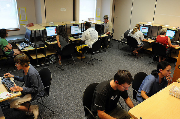 Loveland Public Library users fill the computer lab on Monday morning. The new library expansion is expected to include a larger computer lab and more areas for laptop users. The Friends of the Loveland Public Library will hold an ice cream social from 4 to 6 p.m. this Sunday to raise money for renovating and expanding the library.