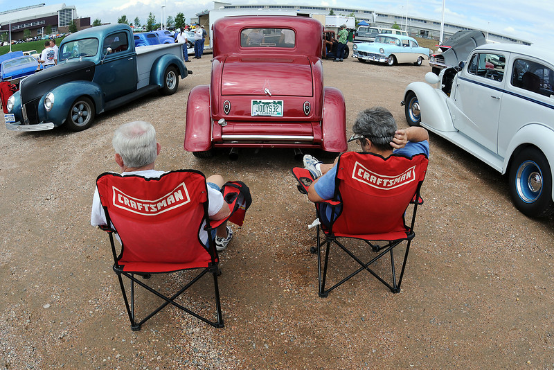 Bob and Jody Harrison of Greeley hang out behind their 1932 Ford Five Window Coupe during last year's Road Knight's Car Show at The Ranch.