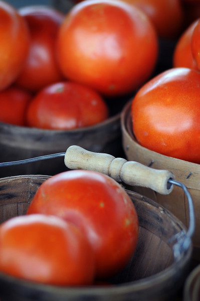 Tomatos from Miller Farms await purchase Tuesday during the farmers market at the Hobby Lobby parking lot in Loveland.