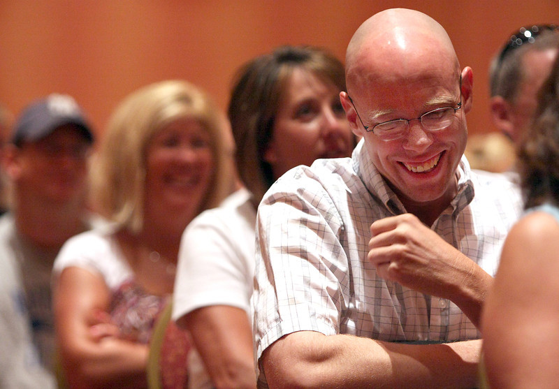 Bill Renzelman, a seventh grade math teacher at Turner Middle School, laughs while Thompson School District superintendant, Ron Cabrera, gives a speech to all of the districts teachers on their first day back Monday at the Embassy Suites in Loveland.