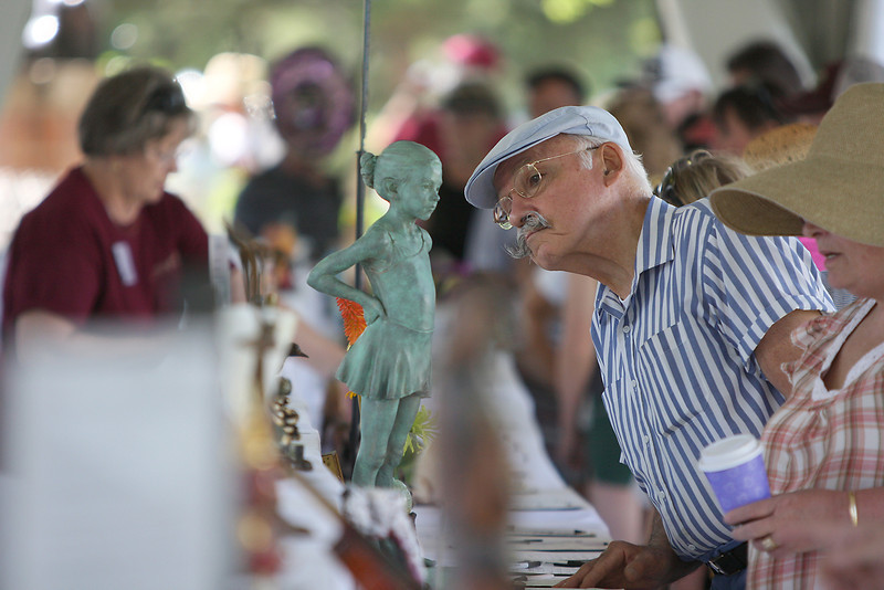 Boulder resident, Bill Border, looks at sculptures in the silent auction.