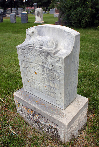 "The gravestone for Gladys Marie Rood at Lakeside Cemetary features a sculpted lamb on the top and an inscription beneath that reads ""Out Darling."" She was born Sept. 5, 1909, and died just four months later. About 112 new grave sites have opened in the cemetary with the closure of access roads there."