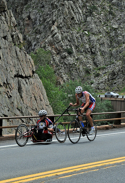 Army Veteran Nathan Hunt is helped by the founder of Ride 2 Recover John Wordin as they make their way to Estes Park on Sunday. Nathan, 29, lost his legs in an explosion in Baghdad.
