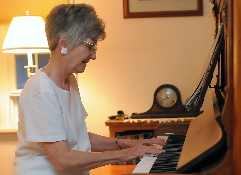 New Life Quartet piano accompanist Angel Street plays a song during a rehearsal of the group on Tuesday, July 27, 2010.
