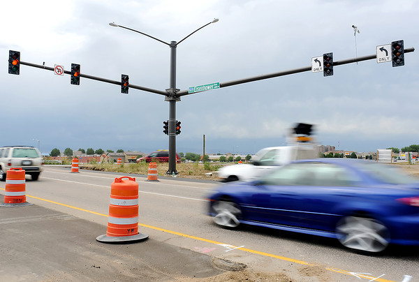 Automobile traffic streams west on Eisenhower Boulevard over Interstate 25 on Wednesday past one of the newly-installed traffic signals as part of the interchange's redesign.