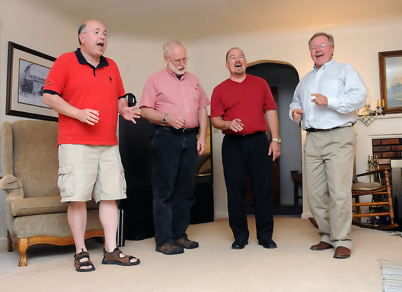 Members of the New Life Quartet sing a song together during a practice session on Tuesday, July 27, 2010. From left are Bill Stratton, Mike Sheppard, Mickey Leonard and Brian Chambers.