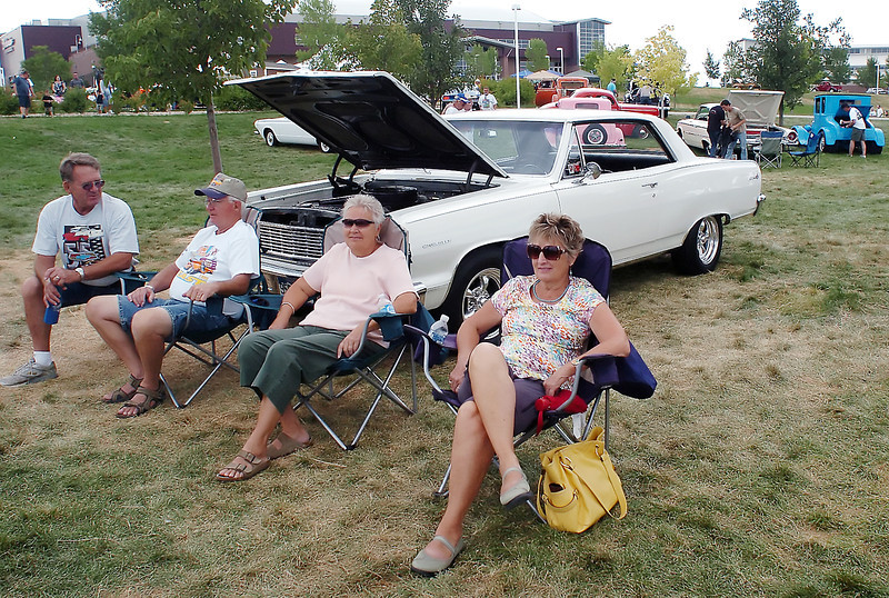 Road Knights Blue Light Special car show attendees, from left, Gary Stratton, Gene Walters, Pat Walters and Mary Jane Ross sit together in front of the Walters' 1964 Chevelle Malibu SS on Saturday, Aug. 14, 2010 at The Ranch.