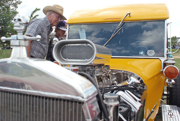 Loveland resident Darold Arbuthnot, left, and his grandson, Trystan Tams, 12, of Johnston look at a customized 1923 Ford on display during the Road Knights Blue Light Special car show on Saturday, Aug. 14, 2010 at The Ranch. The show continues today from 8 a.m. to 3 p.m. with the awards ceremony scheduled for 1 p.m.
