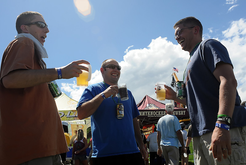 Windsor resident Chris Karr, left, Cory Miller of Loveland and Mark Furmanek, also of Windsor, share a laugh while attending the Gnarly Barley Brew Fest on Saturday at The Ranch.