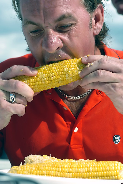 Peter Grahm of Loveland competes in the corn eating contest Saturday during the Loveland Corn Roast Festival on at Fairgrounds Park.