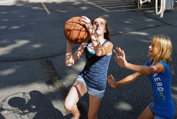 Mikayla Ridenour, 11, left, and Mariah Diedikeer, 11, play a game of one-on-one basketball while attending the Good Neighbor Festival on Sunday, Aug. 22, 2010 at First United Methodist Church, 533 N. Grant Ave.