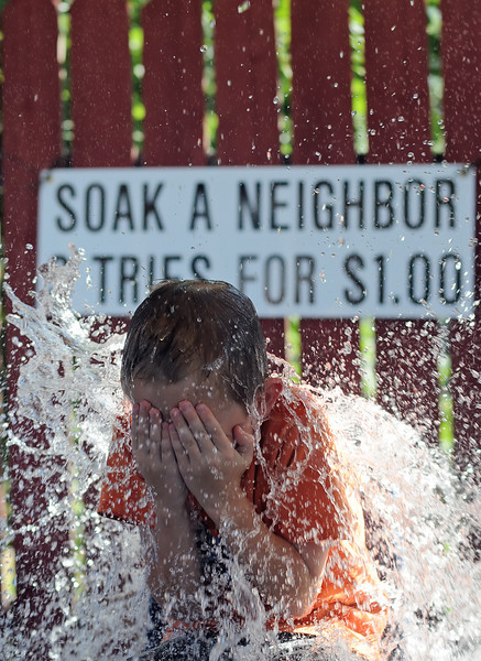 Eight-year-old Zachary Huss is drenched by water at the Soak a Neighbor booth during the Good Neighbor Festival on Sunday, Aug. 22, 2010 at First United Methodist Church, 533 N. Grant Ave.