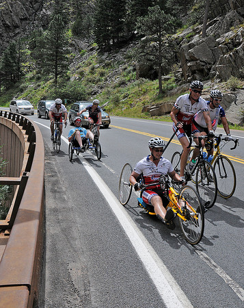 Some of the nearly 100 bicyclists making their way to Estes Park on Sunday to raise  money and awareness of cycling programs to help injured veterans. The group of mostly U.S. veterans started the day in Cheyenne, Wyoming before coming through Loveland on their way to Estes Park.
