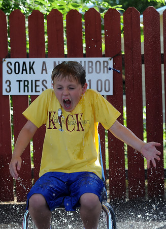 Lincoln Solt, 8, is drenched by water at the Soak a Neighbor booth during the Good Neighbor Festival on Sunday, Aug. 22, 2010 at First United Methodist Church, 533 N. Grant Ave.