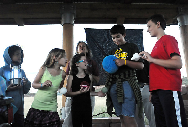 Deborah Price, back, gives a demonstration during an event Thursday evening at the Bobcat Ridge Natural Area on the Perseid meteor shower. Helping with the demonstration by representing the positions of the sun and planets are , front from left, Ben Nortey, 10, Rachael Cabezas, 8, Addison Elkin, 8, Andrew Cabezas, 13, and Connor Elkin, 12.