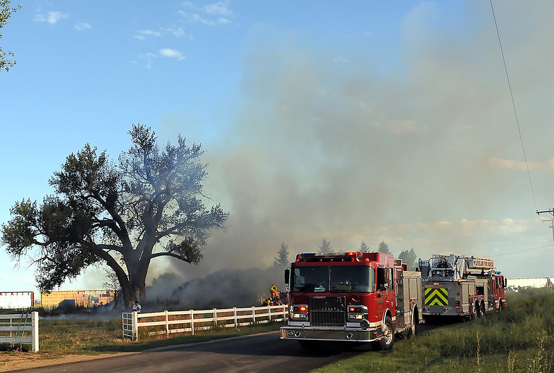 Firefighters work the scene of a structure fire east of Loveland on Tuesday evening at Kelim.