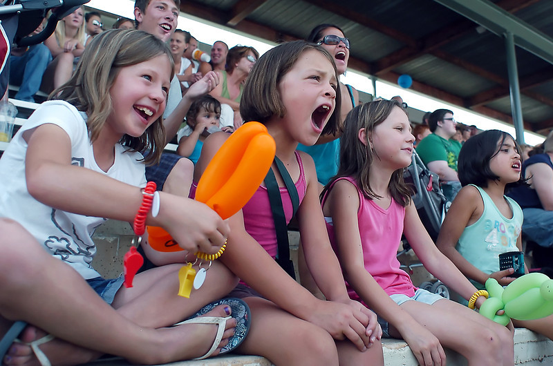 Loveland Corn Roast Festival attendees cheer on contestants during the corn eating contest on Saturday from the grandstand at Fairgrounds Park. Front from left are Hailey Sundby, 7, Adisyn Banker, 7, Payton Jonason, 7, and Emma Duran, 7.