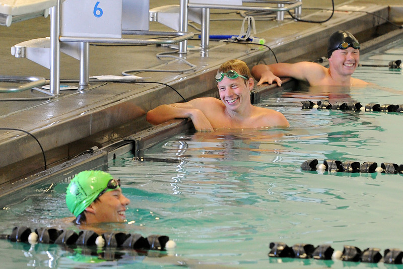 Nick Hatanaka, left, Ryan Ball and Brandon Hatanaka share a laugh while giving a swimming demonstration for Loveland Swim Club members during an end-of-season celebration at the Mountain View Aquatic Center on Tuesday, July 31, 2012.