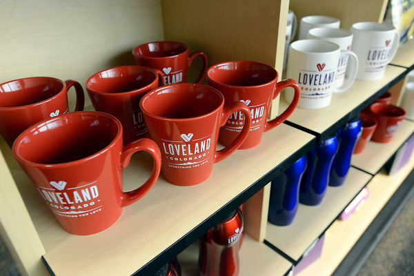A variety of items or offered for sale at the Loveland Visitors Center including coffee mugs and water bottles.