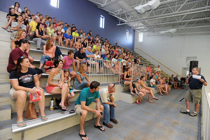 Jim Nickell, right, head coach and CEO of the Loveland Swim Club speaks to swim club members and their parents during an end-of-season celebration at the Mountain View Aquatic Center on Tuesday, July 31, 2012.
