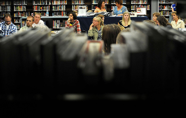 Teachers new to the Thompson School District listen as Linda Barker, director of teaching and learning with the Colorado Education Association speaks about the benefits of joining the Thompson Education Association during new teacher orientation at Thompson Valley High School on Friday morning.