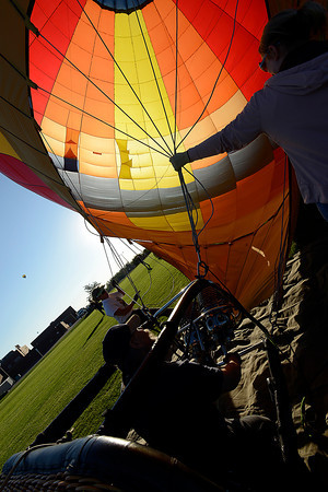 Crew members rig the 's Wonderful hot air ballon before launch Friday.