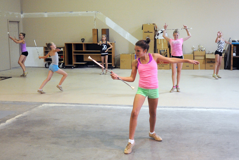 Claire Van Buskirk, 12, front, and other baton twirlers practice their solo routines on Thursday, Aug. 16, 2012 at the Rocky Mountain Golden Girls Baton Academy, 534 W. 66th St. in Loveland.