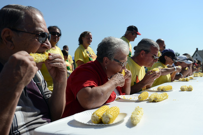 Don Jarosik, left, Jerri Jarosik and Trent Turner join others at the table during the Old Fashioned Corn Roast Festival's corn eating contest on Aug. 25, 2012 at Fairgrounds Park.