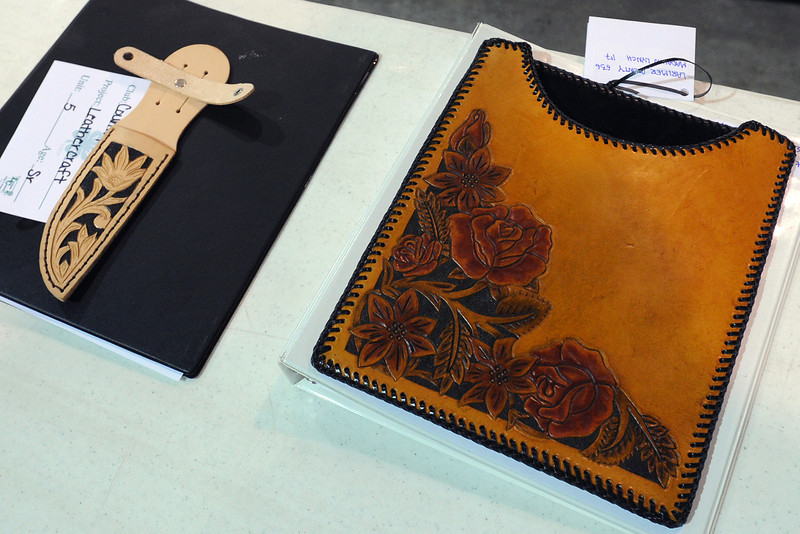 A knife sheath made by Kendra Betz and iPad case by Madalyn Lynch are among the items entered as part of the leathercraft portion of the 4-H Interview Judging competition on Tuesday, July 31, 2012 inside the Thomas M. McKee 4-H, Youth & Community Building at The Ranch.