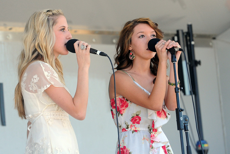 Mira Conaway, 16, left, and Isabella Willis, 16, sing an encore performance after being named winners of the Ears class of Loveland's Got Talent on Saturday, Aug. 25, 2012 at Fairgrounds Park.