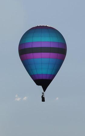 A hot air balloon flies over Loveland Friday.