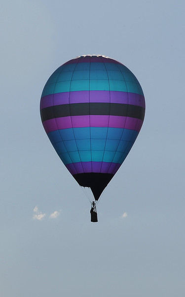 A hot air balloon flies over Loveland Friday.