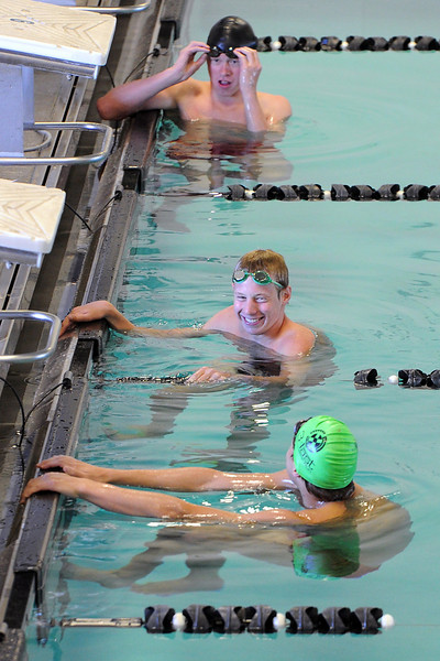 Nick Hatanaka, bottom, Ryan Ball and Brandon Hatanaka prepare to give a swimming demonstration during an end-of-season celebration for the Loveland Swim Club at the Mountain View Aquatic Center on Tuesday, July 31, 2012.