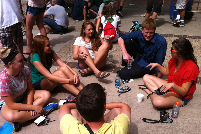 The first students in line for President Barack Obama's speech pass the time Tuesday afternoon before being let into the venue. At right are Haleigh Hamblin, who arrived at 11 p.m. Monday, and Brandon Tejera, who said he got in line at 5 a.m. Tuesday. (Photo by Craig Young)