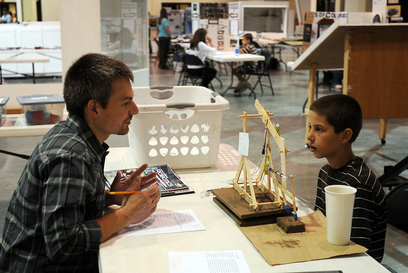 Christian Scandrett, 9, right, chats with robotics judge Josh Orrison about his project during the 4-H Interview Judging on Tuesday, July 31, 2012 in the Thomas M. McKee 4-H, Youth & Community Building at The Ranch.