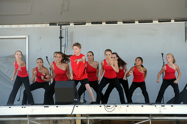 Essence Dance team members from Berthoud perform onstage at Fairgrounds Park during Loveland's Got Talent competition on Saturday, Aug. 25, 2012.