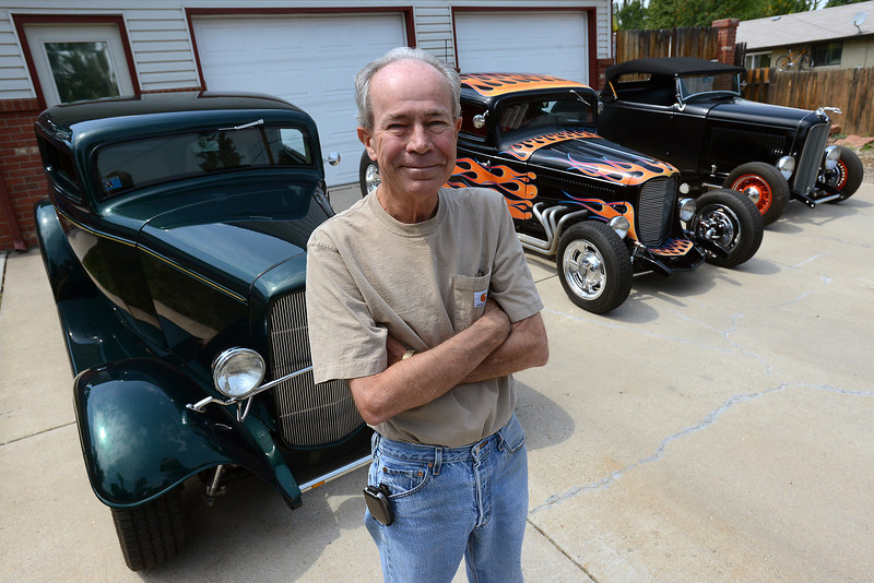 Loveland resident Dean Buhler, one of the founders of the Road Knights Car Show, poses in front of his collection of 1932 Ford 3-window coupes, at left and middle, and roadster at right on Thursday, Aug. 8, 2012. The annual Blue Light Special car show takes place at The Ranch from  2 p.m. to 9 p.m. today, 9 a.m. to 5 p.m. Saturday and 9 a.m. to 2 p.m. on Sunday.