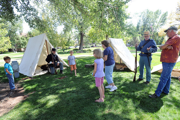 "Visitors to the Loveland Public Library check out an 1860s-era soldiers' camp set up outside the library building on Saturday, Aug. 18, 2012 as part of the ""Lincoln: The Constitution and the Civil War"" exhibit. From left to right are Dominik Rice, 5, Niko Rice, 19, Jonathan McLaughlin, 6, Ruby McLaughlin, 8, Sharon Ritchey, Geoff Hunt and Larry Gillam."